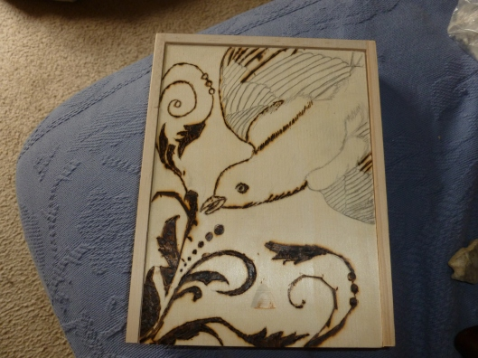 A partially done box for my magpie smudge wing, 2nd attempt at woodburning